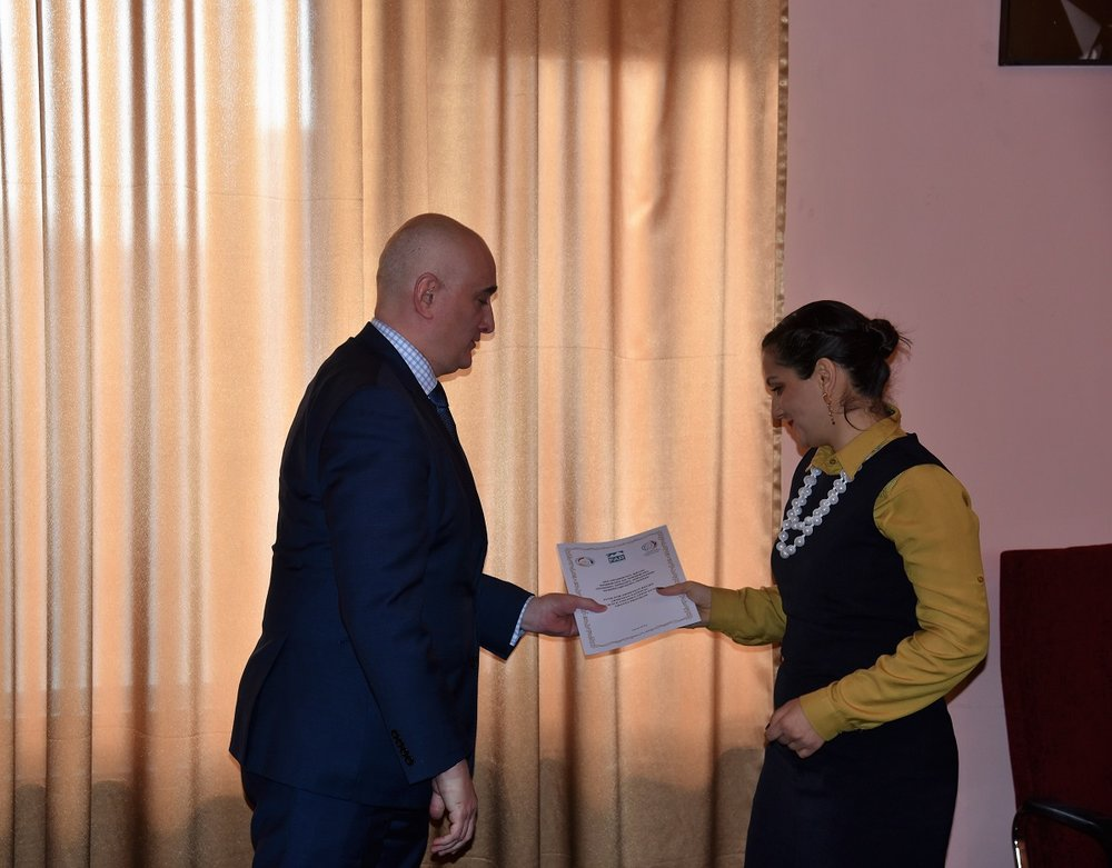 12  Alexandr Ter-Hovhannisyan  giving a certificate to young scientist -winner of scpecial award.JPG