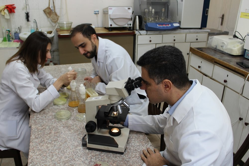 20.  ANSEF NS  microbio-4676 research group during work.JPG