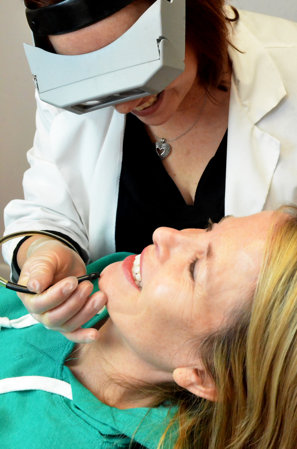 Teresa uses the method of electrolysis for hair removal on the chin of a client.