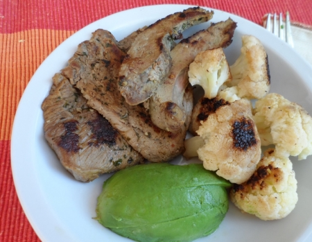 A typical lunch: 100 grams of beef (left), 50 grams of beef liver (top), 1/2 avocado, roasted cauliflower.