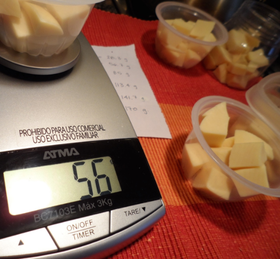 56.7 grams equals 2 oz of cheese. Shown here is a semi-hard cheese called Fynbo, similar to Monterey Jack.