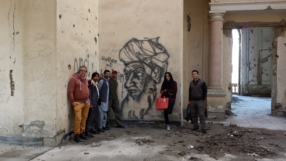With student contributors to  The Gifts of the State  at Darul Aman Palace in Kabul, Afghanistan in 2013 Photograph by Paul Revere