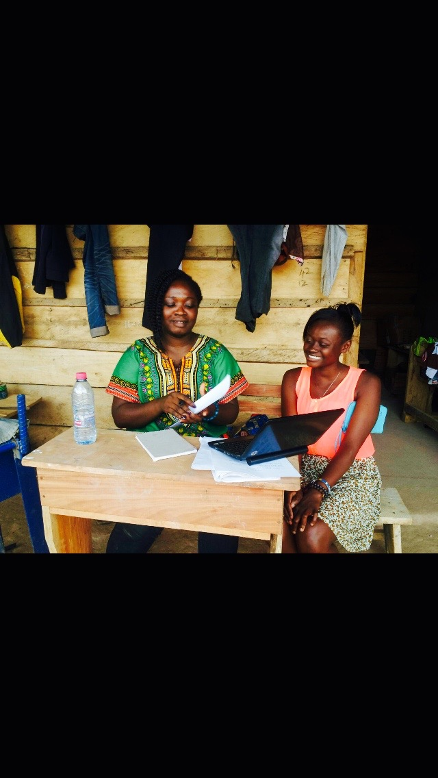 14. Headmistree Rejoice and student Portia, going through her application prior to school opening - April 2015.jpg