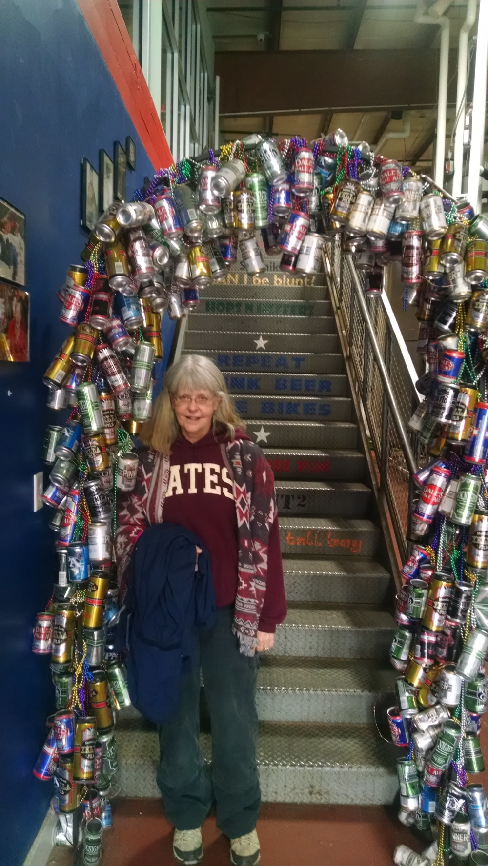 Susan surrounded by empties (not hers!) at Oskar Blues in Brevard