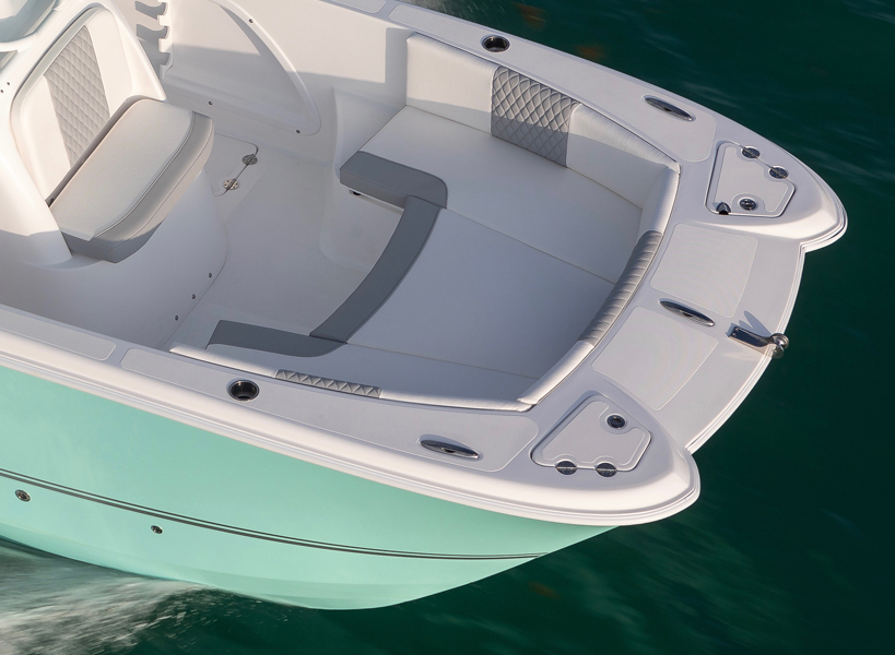 Comfortable Bow Layout - The bow of a dual-hull Twin Vee offers one of the widest bow's in the marine Industry. There is no denying the added roomy seating this boat offers. The 240 CC is designed with entertainment and versatility in mind. Features include wrap-around seating with all the cushions, removable backrests, 2 easily accessible large storage boxes, drink holders and speakers to play your favorite tunes.