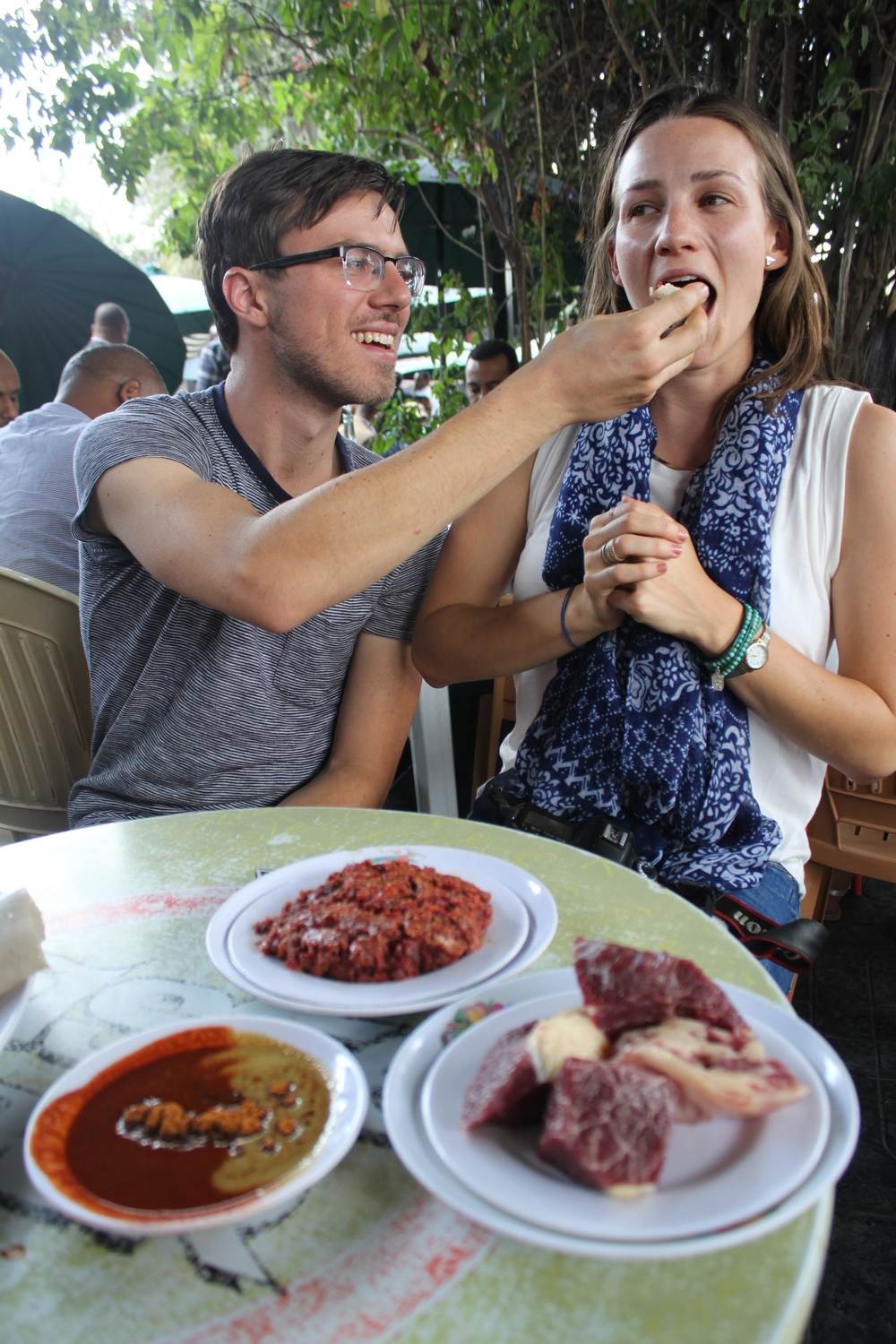 Co-Founder Xavier feeds co-founder Eliza a Gursha