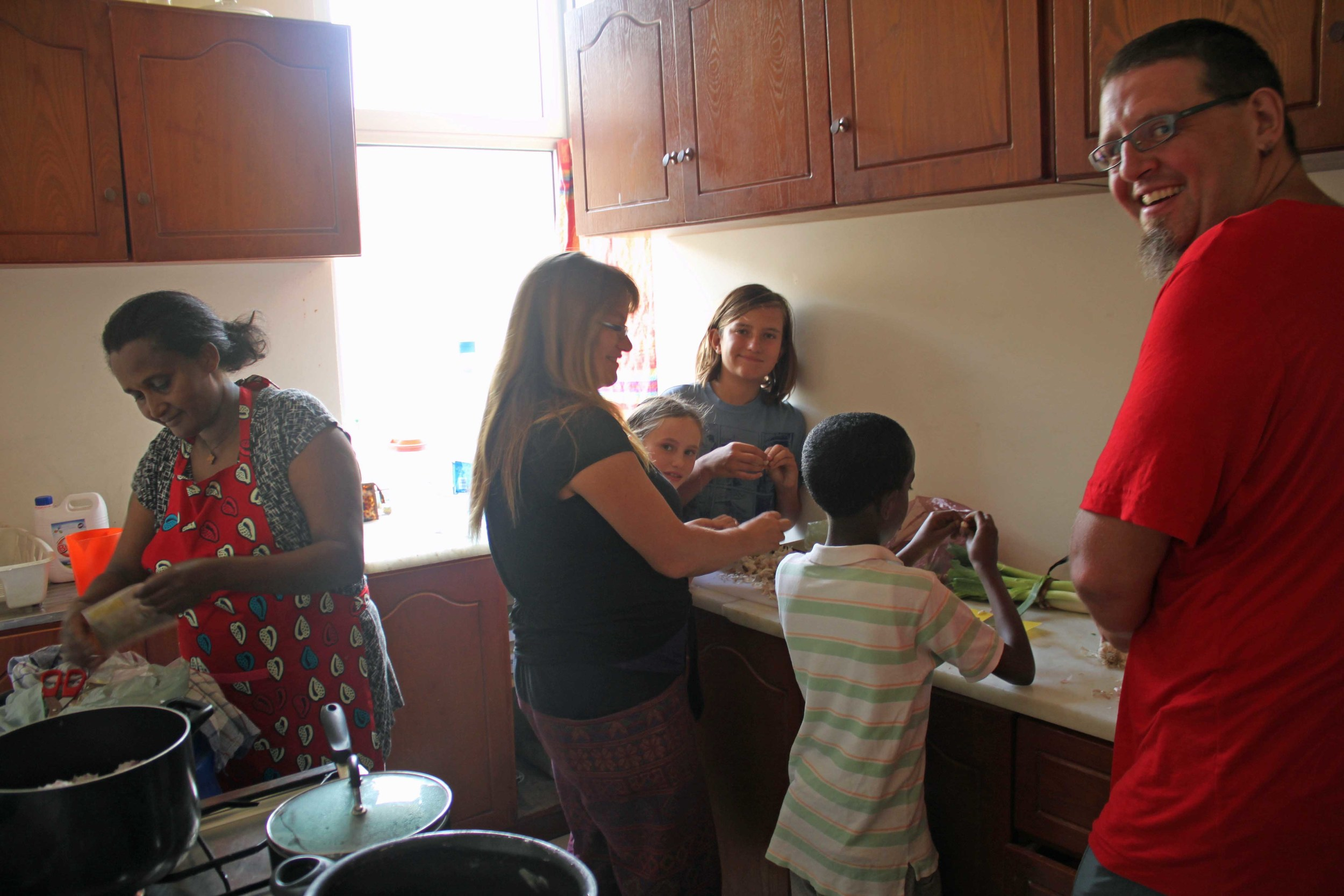 Sebastian and his family learning to cook Ethiopian food.