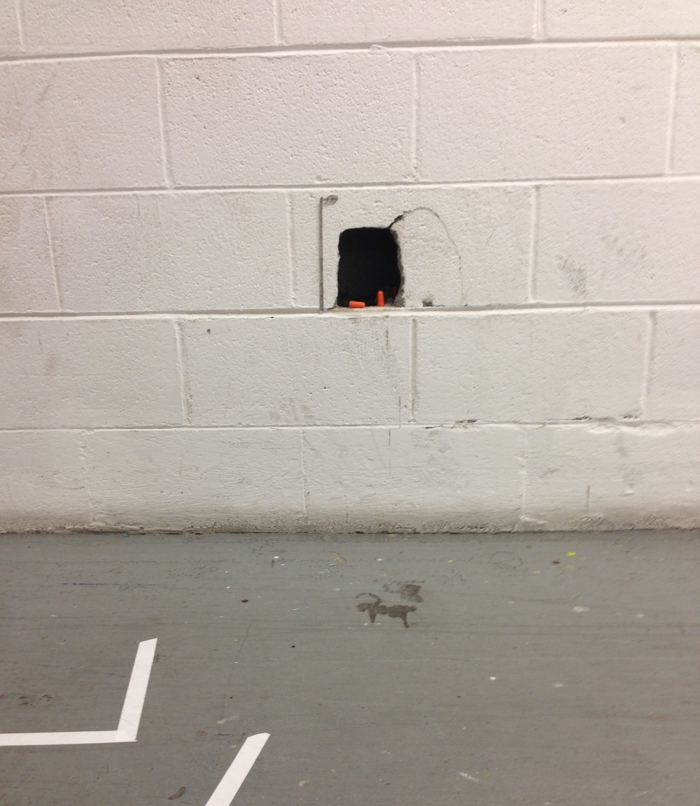 Provisional Negative Negative Sculpture with Lamppost,  site-specific sculpture, breeze block wall, foam ear plugs, pencil on paper,  2015