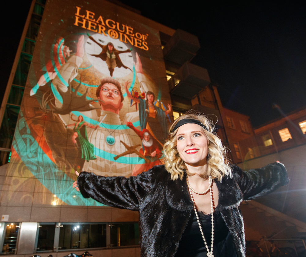 Actress Amy de Bhrún stars as Ireland's great female aviatrix Lady Mary Heath at the Illuminate Herstory 2017 installation on Palace Street Offices, Dublin. Photo credit: Andres Poveda