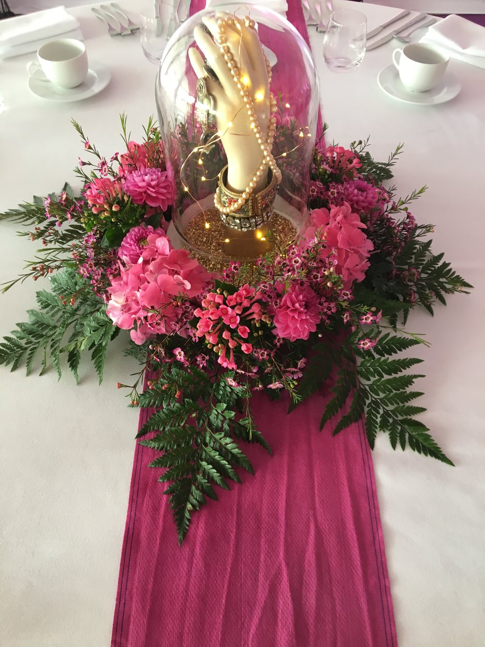 Pink arrangement and bell jar Theatre Of Flowers.JPG