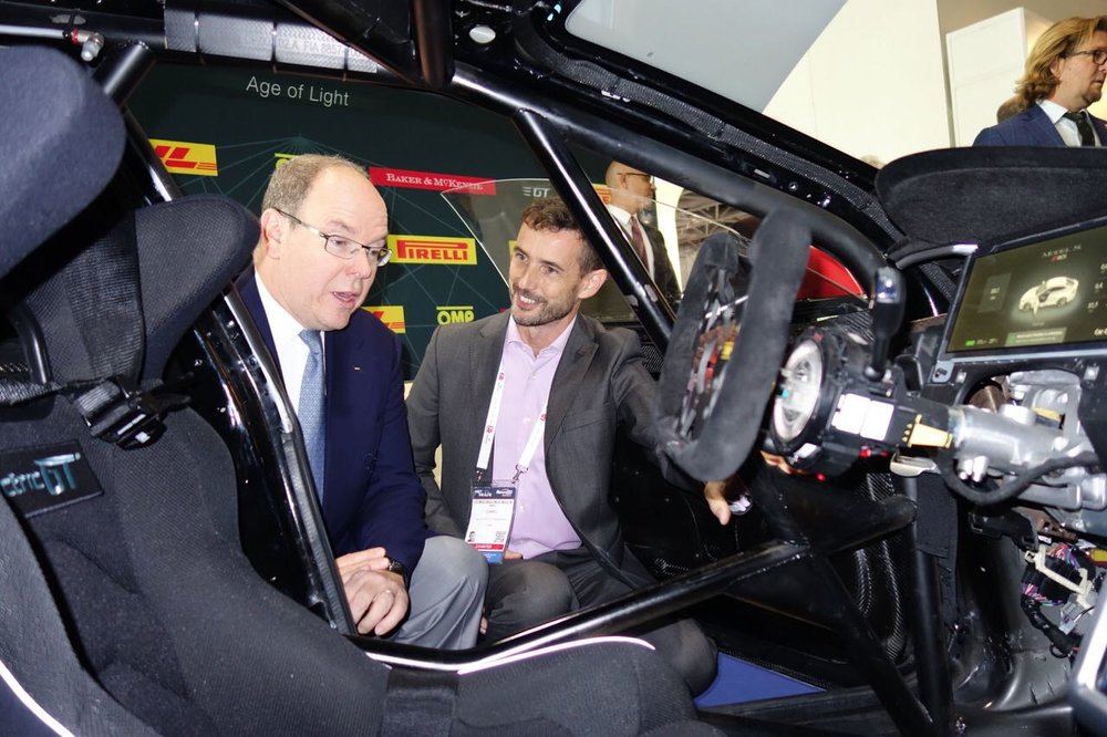 His Highness Prince Albert of Monaco views the Electric GT Tesla race car with CEO Mark Gemmell at Sportel 2016