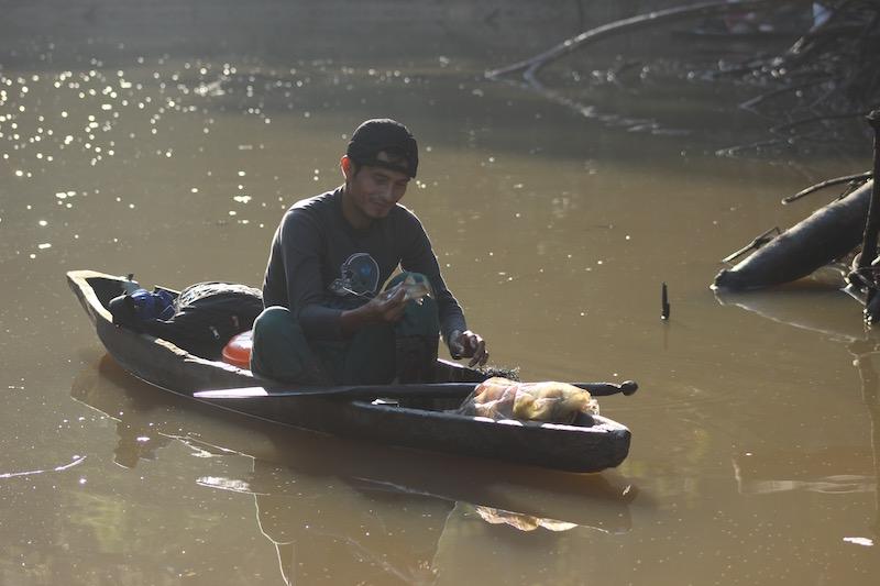 Walter x 3 - Sinchicuy Amazon Lodge - Man in Canoe.jpg