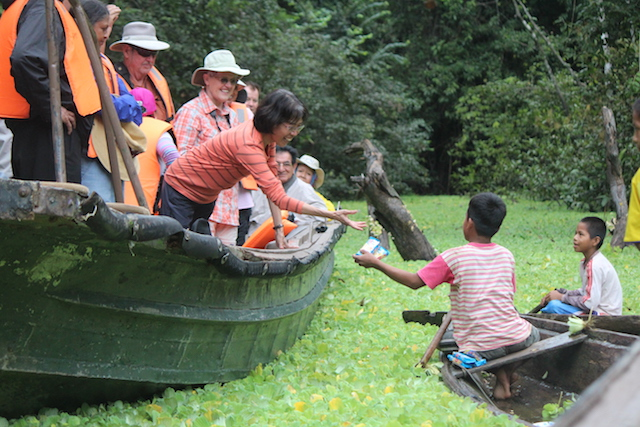 Amazon River Cruises - Buying from Locals.JPG