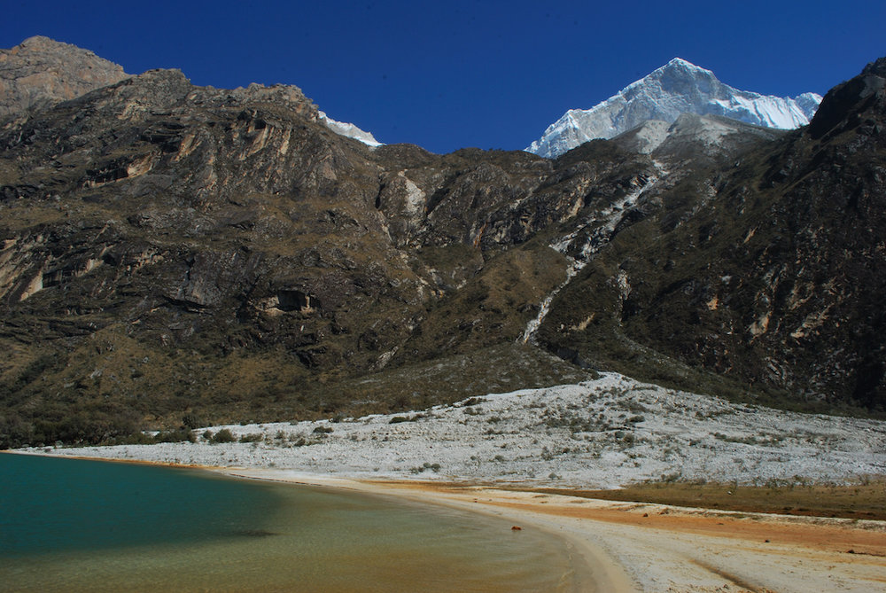 Snow-capped peak of Huandoy Mountain visible from Llanganuco Lakes.