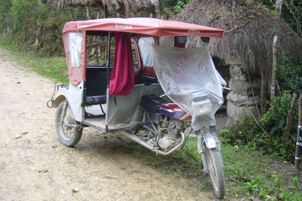 Mototaxi with temporary 'windscreen' in place.