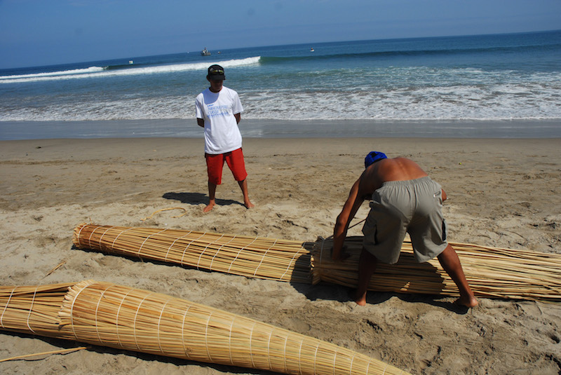 Construction of  caballitos de totora  is back-breaking work in the sun.