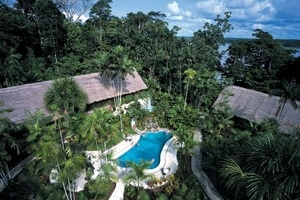 Ceiba Tops - Daily Rate: from £165 / $210 ppDistance from Iquitos?33 km (21 miles) downstream✘ Protected Area✔ A/C✔ Private Bathrooms✔ Electricity✔ WiFi (slow)✔ Swimming pool✔ Canopy Walkway✘ Zip-Lining