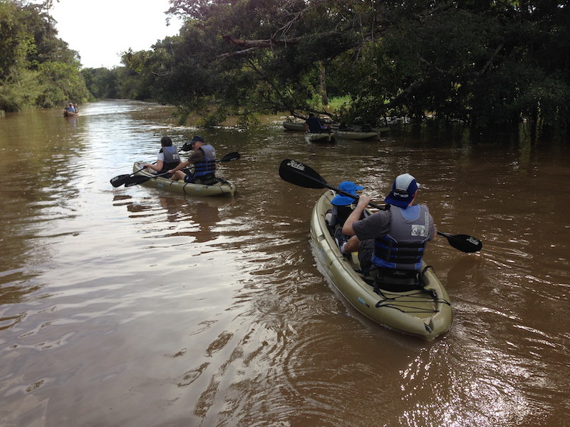 Kayaking along a tributary of the Amazon River.