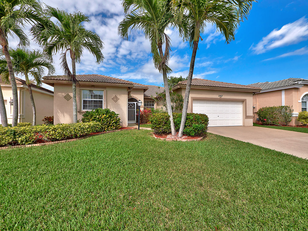 Updated, meticulously maintained w/ spacious, open floor plan in outstanding, gated 55+ community.  Upgrades & Updates throughout. Kit w/Silestone, Stainless Steel Appliances. Large Family Rm opens to Kit. Glass Enclosed SunRoom. Master Suite w/his+her's closets & luxury bath w/double sink vanity, soaking tub, separate shower & water closet. Separate Laundry Rm w/Washer/Dryer, laundry tub & extra cabinets.  Tile Floors throughout/no carpeting. Custom millwork detail. Newer AC. Nice fenced backyard. Quality CBS construction w/accordion hurricane shutters.  Summer Chase is the best kept secret in PBC w/low HOA dues (covers lawn maintenance, basic cable & rubbish pick up. Amenities incl Clubhouse, tennis cts, bocce, pool/spa, fitness ctr & fun, inclusive, organized events year round. Pet friendly!