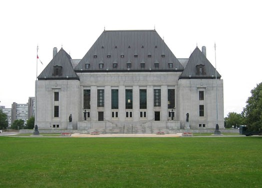 "(""Supreme Court of Canada"" by Peregrine981 - Own work. Licensed under Public Domain via Wikimedia Commons - https://commons.wikimedia.org/wiki/File:Supreme_Court_of_Canada.jpg#/media/File:Supreme_Court_of_Canada.jpg)"