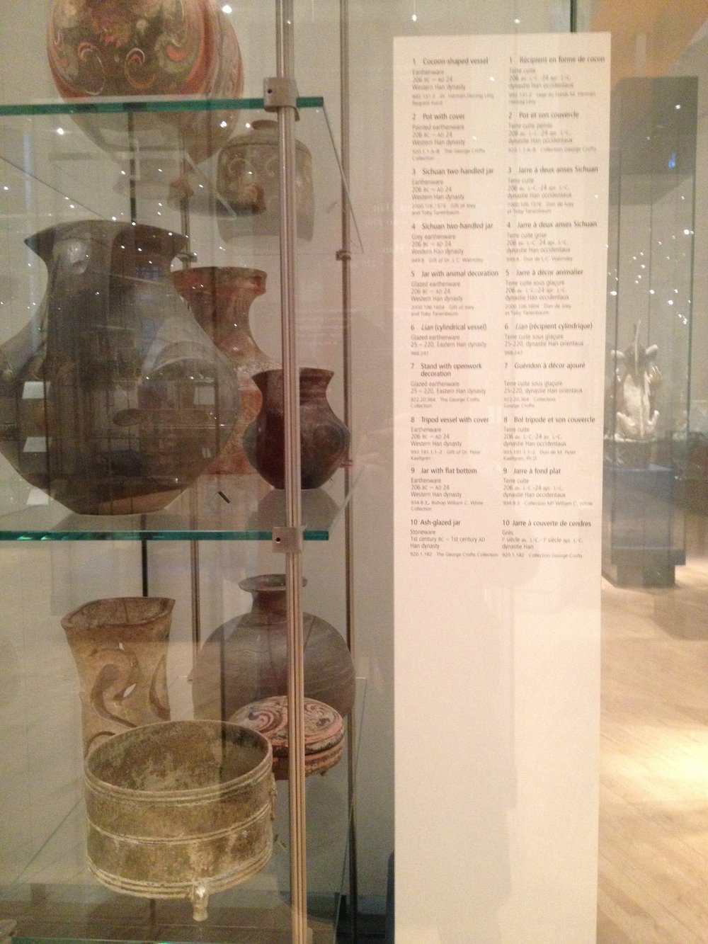1. A detailed list of the items displayed in this exhibit case (Ancient China exhibit). - These cards lend credibility to the artifacts. It tells us where they came from, who curates them, and what particular collection they belong to + year found.