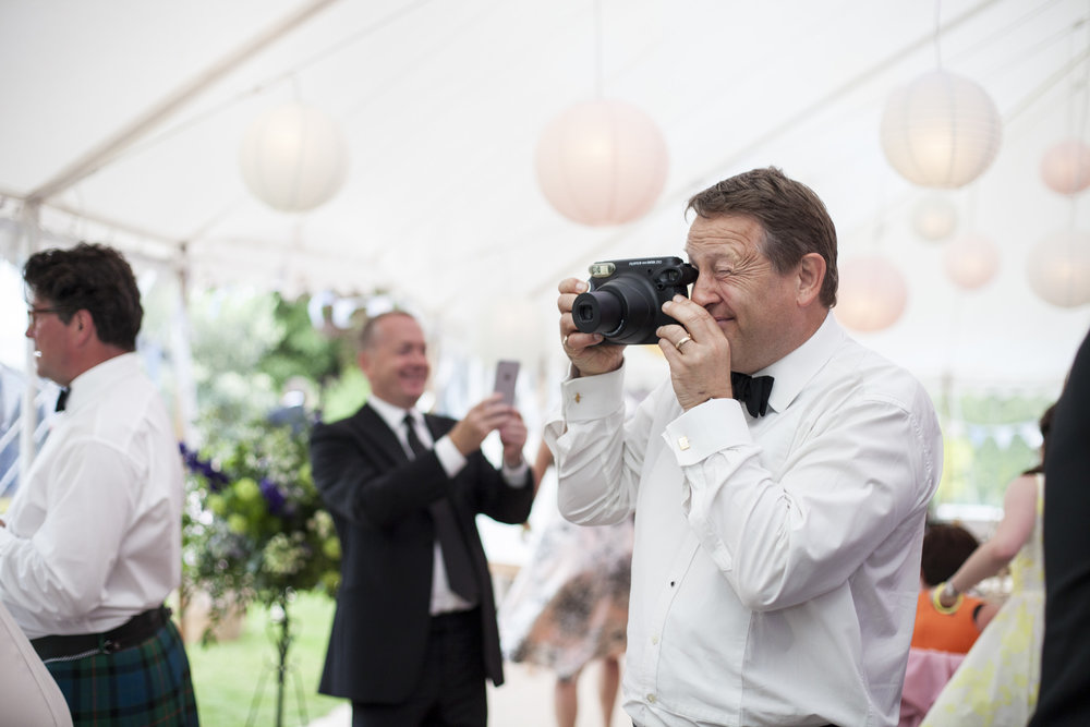 Unplugged wedding guest taking photos