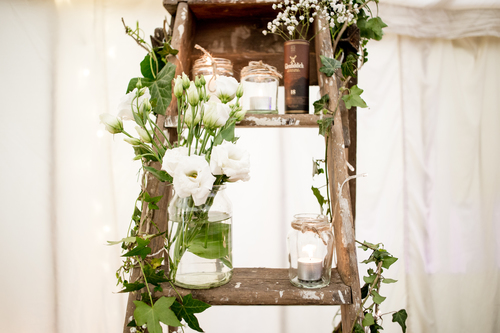 wedding lader styling with jam jars, foliage, ivy and rustic