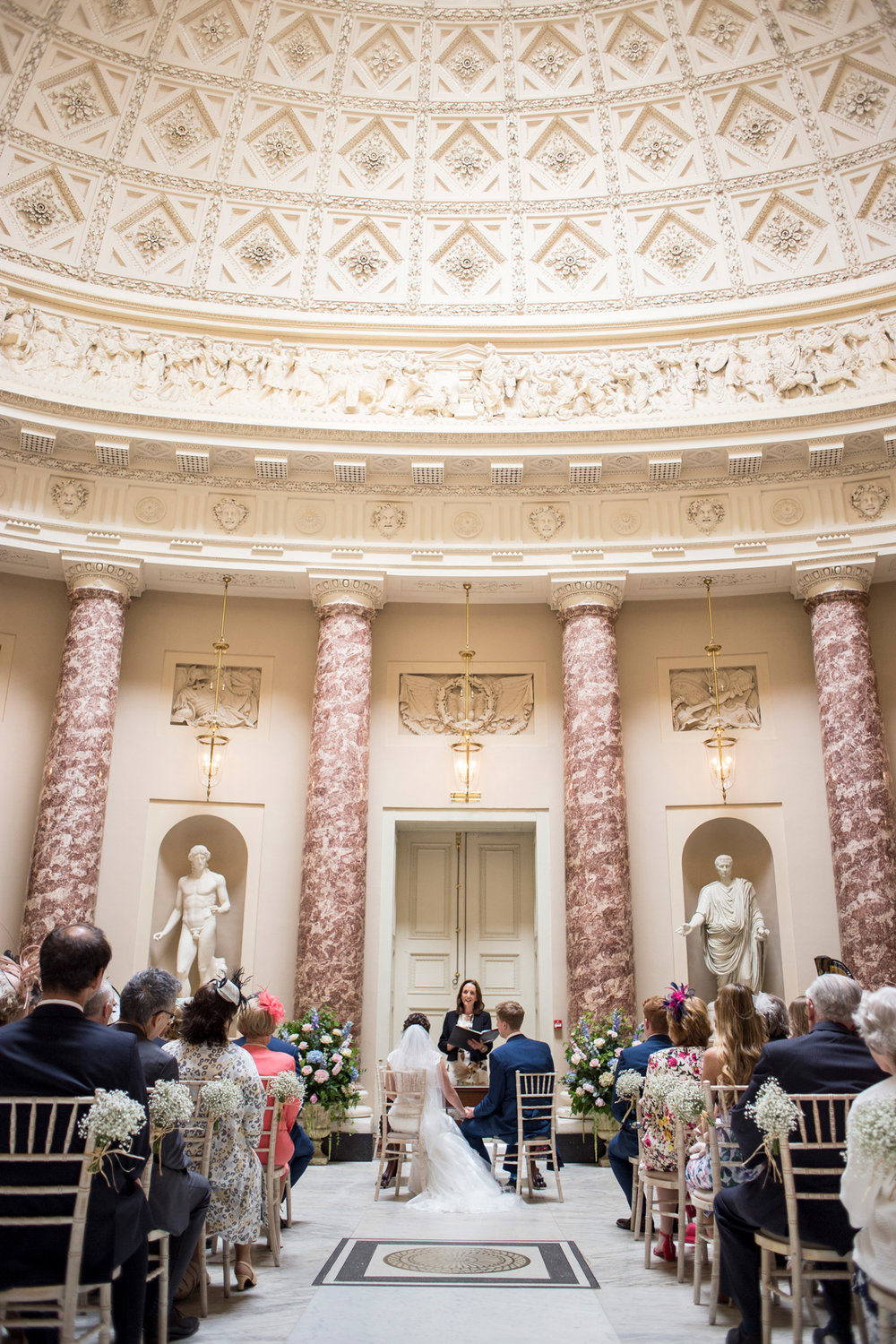 Ceremony room, bride, groom, marble,