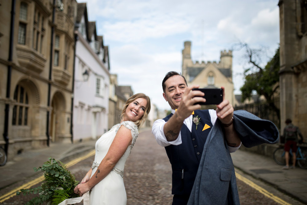 bride and groom take selfie
