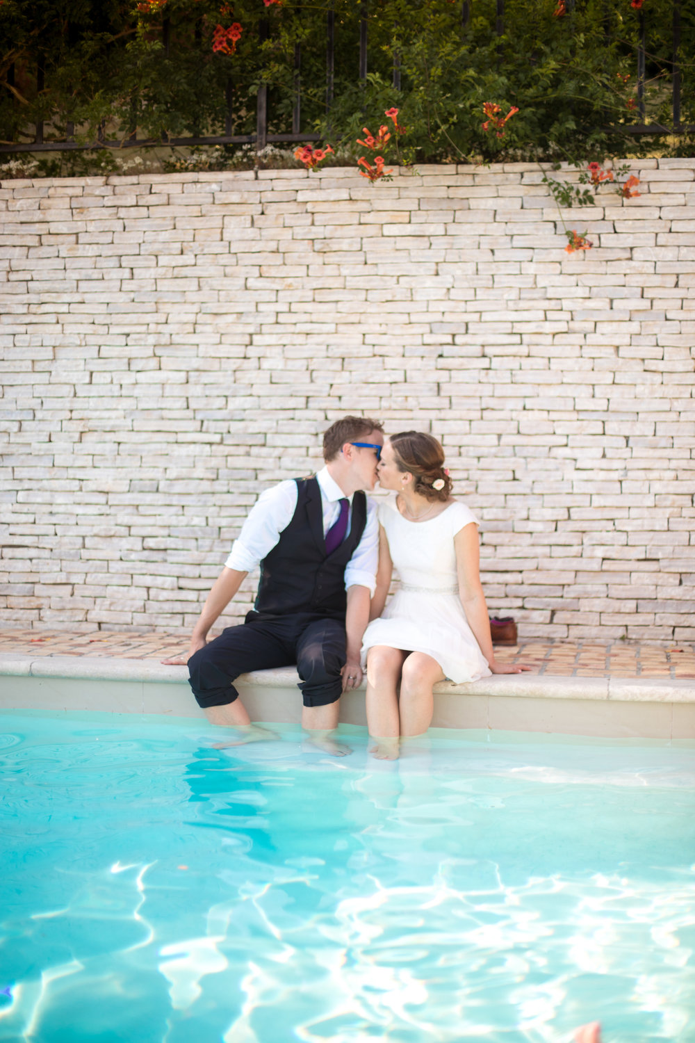destination wedding in Europe of couple sat in swimming pool