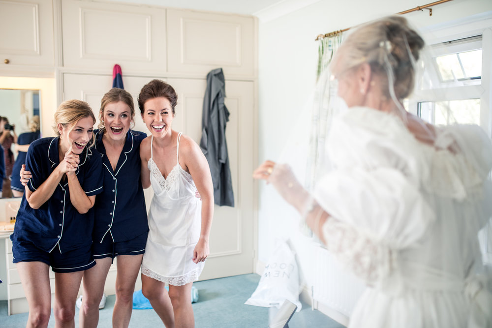 brides mum wears wedding dress at home wedding