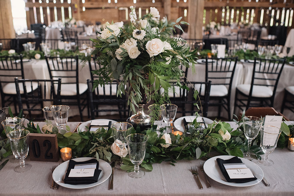 Photo by  Hugh Whitaker   —  Floral arrangements by Karen Cal of  Cedar & Stone Floral Studio .