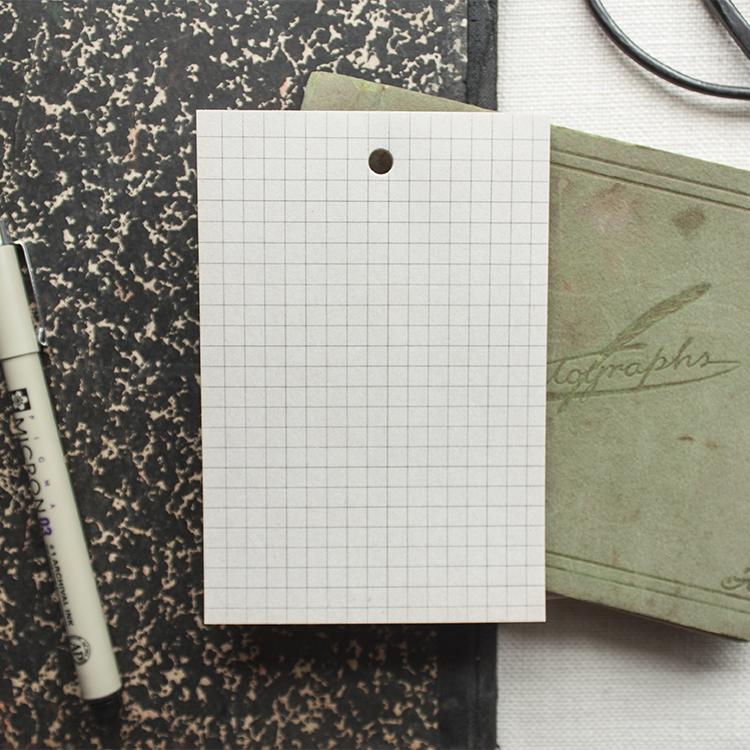 Grid Newsprint Notepad - $4.00