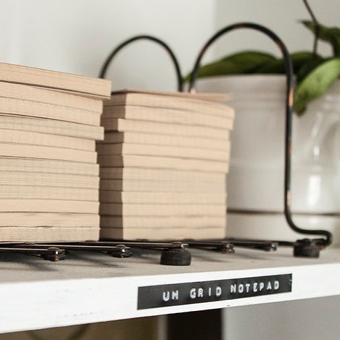 Shelves are stocked with notepads... and other fun stuff 🌿📜🔝