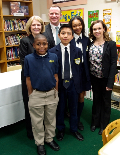 (Left to right): The Archdiocese of Cincinnati Interim Superintendent Susan Gibbons, Accelerate Great Schools CEO Patrick Herrel and Emily Gilbride, Cincinnati Manager for Seton's Blended Learning Initiative, pictured with St. Joseph Catholic School students