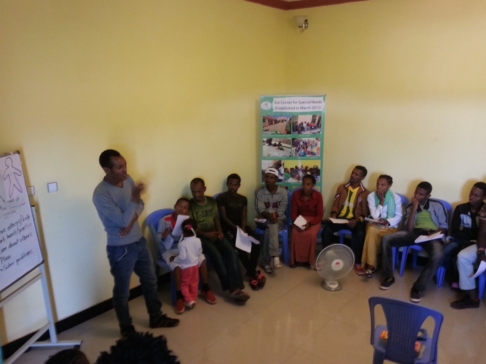 """Conducting an """"Introduction to Leadership"""" training for 36 Deaf young adults at the Center (August 2015)."""