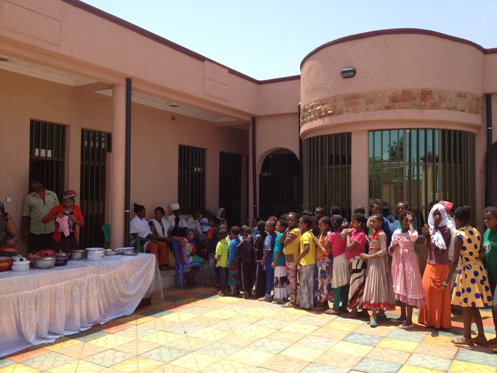 Students line up for lunch at a special summer program organized at the Center (June 2015).