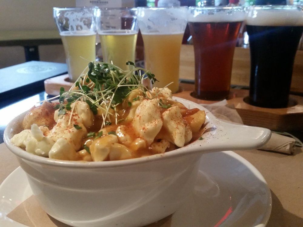 Poutine + a flight of beers (Mobile photo: Samsung Galaxy s5 + VSCO)