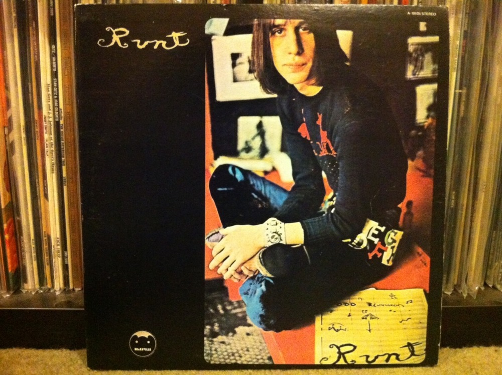 Runt is no small feat.    Make no mistake. Runt is the band that is Todd Rundgren. It's supposedly a real band but I have my doubts. From where I sit, I guess Todd Rundgren – the Philly based anglophile rocker from The Nazz – had so much faith in his first solo album that he didn't put his name on it anywhere. Almost. If you look closely you can see he scribbled it on some paper in the bottom right corner of the album cover. Not a confident start, really. Though a great one.   The Nazz. Now that was a band. Three great albums if you ask me. If you ask Todd Rundgren he'd give you the usual tortured artist story about only wanting to release one good album, couldn't sing on his own songs (nearly all of them) and that the record company released sub-par material on Nazz Nazz and Nazz III. I'm not having any of it. Great records. All of them, Todd. All.   Back to Runt. It came out in 1970 and as far as I can tell, the songs fit into three basic categories. All out rockers (Broke Down & Busted, Who's That Man?, Devil's Bite). Tentative sad sack stuff of legend (Believe In Me, Once Burned, I'm In The Clique). Hit record attempts [We Gotta Get You A Woman, Don't Tie My Hands (which is really part of a weirdo trilogy song thing)].   Now that we're on the topic, Mr. Rundgren did score a hit with We Gotta Get You A Woman. I think he wrote that for Joe Namath based on a misunderstanding that Joe was tentative with girls.   This entire record is self-conscious, claustrophobic and great. It's just plain great. I don't understand any of it but I love it.   I'm not sure what the malady is called, but in my opinion Todd Rundgren suffered from a rare disorder early in his career where he actually believed he was a black British soul singer who became all four Beatles. Imagine the waistcoats he must own! The good news is that Todd Rundgren really knew how to overcome.   There's something else. I can't prove it, but I strongly suspect that Todd Rundgren taught a high school rock band and jazz combo to play every note of this album over many months fueled by Pixie Sticks, cans of Coke and the promise of groupies only to pull the rug out from under them, wipe all their performances from the master tapes and re-record every note himself. In his grandmother's basement.   Runt. A self-aware pop masterpiece.      Listen to Broke Down & Busted by clicking this here link!        For weirdos only:  I looked forever and a day to find my copy of this long player. In a move not out of character with the rock 'n' roll weirdo I described above, there was some controversy over the release of this album. There are supposedly three versions out there – two on Ampex Records (one with twelve tracks; one with eleven). I've got the less desirable ten track version on Bearsville(distributed by Ampex). Rundgren must hate putting out records! And, I had to bust my butt to find a copy of the album that wasn't trashed. They're always beat beyond recognition. Usually the sign of a good album (or any Black Oak Arkansas record).