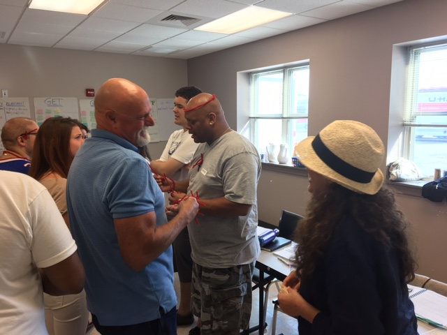 Participants at Haven House,  Allentown, PA  CPS training during interactive BAFA BAFA exercise.