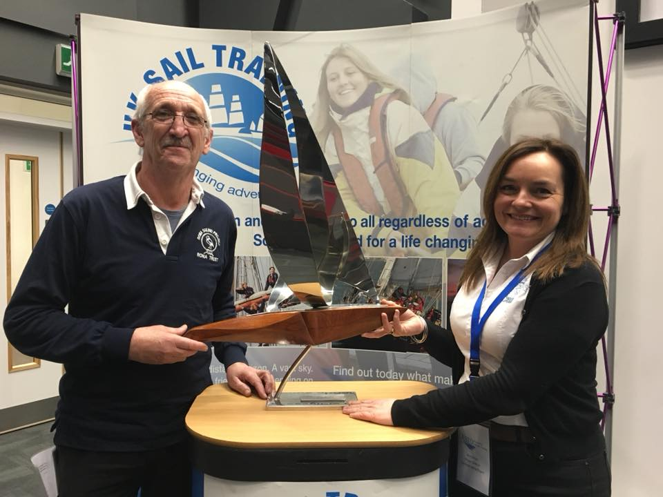 Project Shipwright Mark Norman and Project Director BrId Barrett collecting the MCA/ASTO Vessel of the Year award at the annual Association of Sailing Training Organisations (ASTO) conference, held in Southampton.