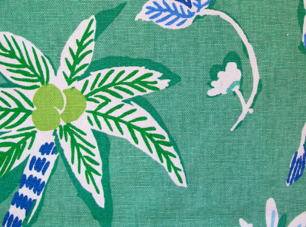 The art style of this bold tropical print has all the innocent charm of a children's coloring book, yet the thoughtful mix of blues and greens keeps the palette tight and polished.