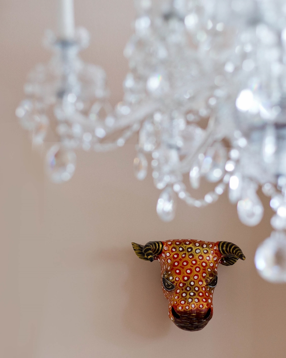 Primitive mask collection and crystal chandelier. Eclectic Northern Virginia, Shenandoah Valley  home. Photo: Matthew Lofton
