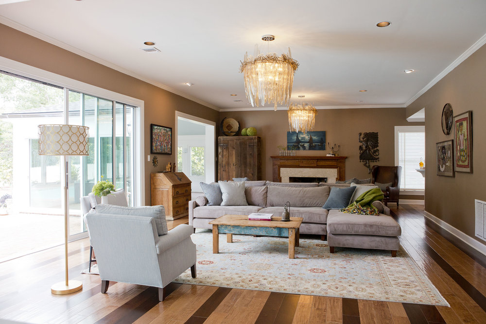 Back to back couches. Back to back sofas. Family room open floor plan solutions. American make furniture upholstery. Show stopping gorgeous chandelier lighting. Statement piece. Room jewelry. Art collection and vintage local art. Winchester Virginia, Shenandoah Valley, Northern Virginia. Photo: Matthew Lofton