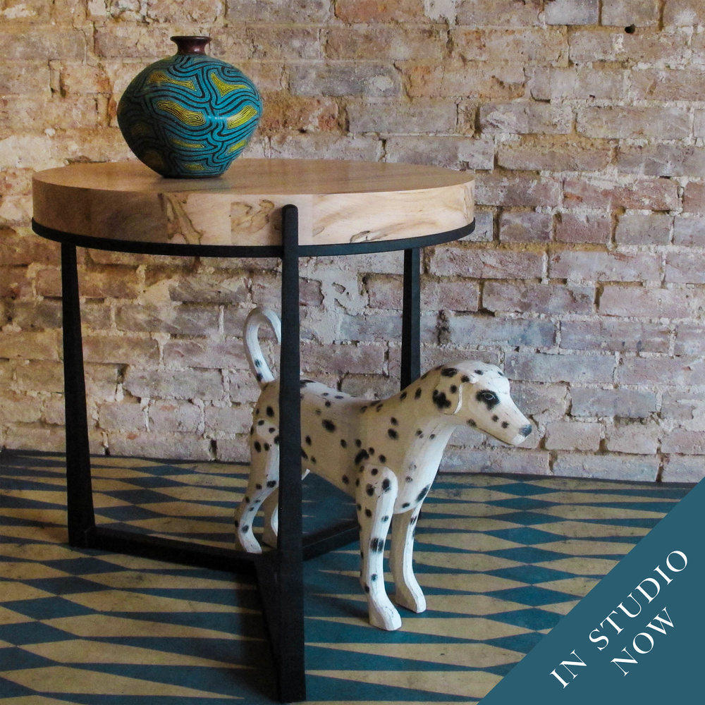 Our Neptune table is the perfect balance of sleek metal lines and substantial solid wood top.