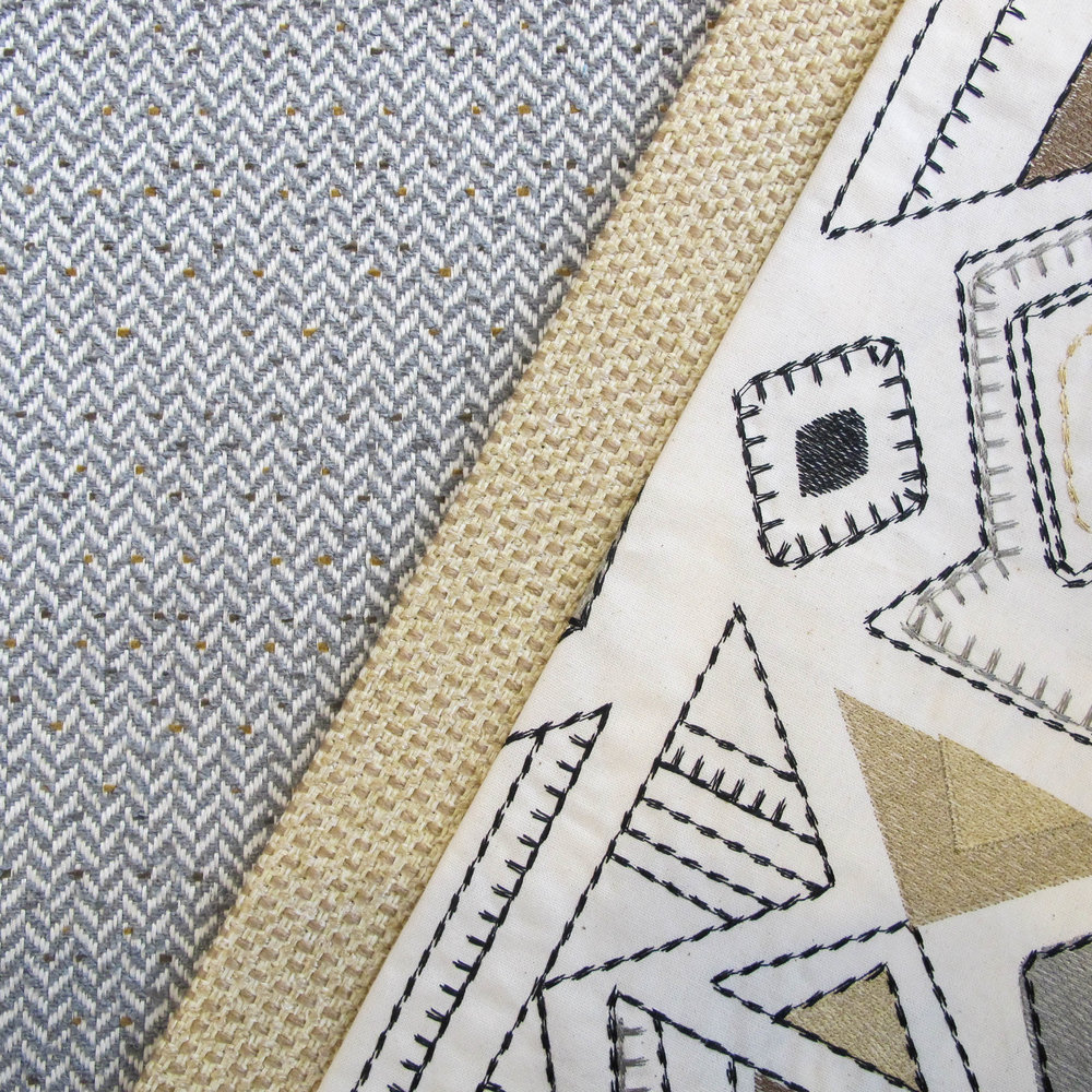 A flecked herringbone echoes the colors in the Aztecan stitch work textile that enlivens this classic fabric story.