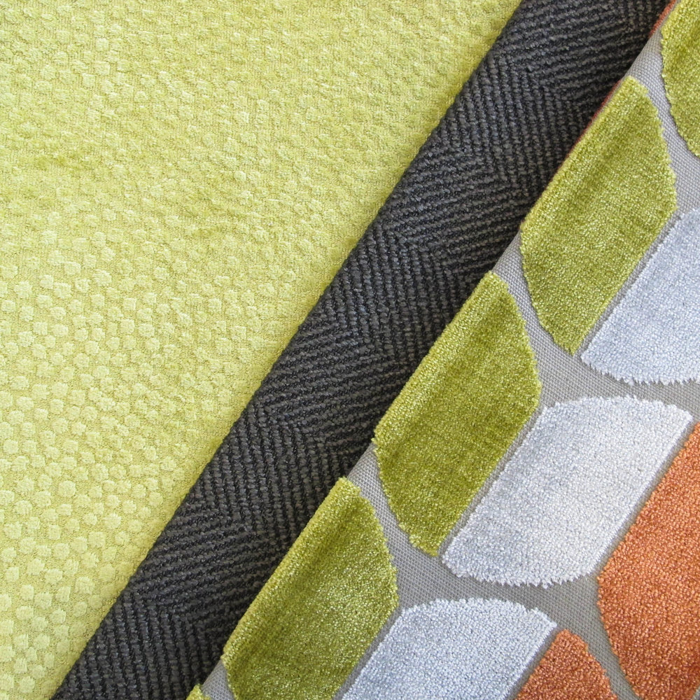 A velvet carved into soft geometrics is the centerpiece to a fabric story developed for high contrast with fresh color.