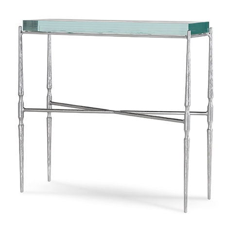 Our Carolina accent table is elegant and constrained, shown in glamorous silver with fused glass top.