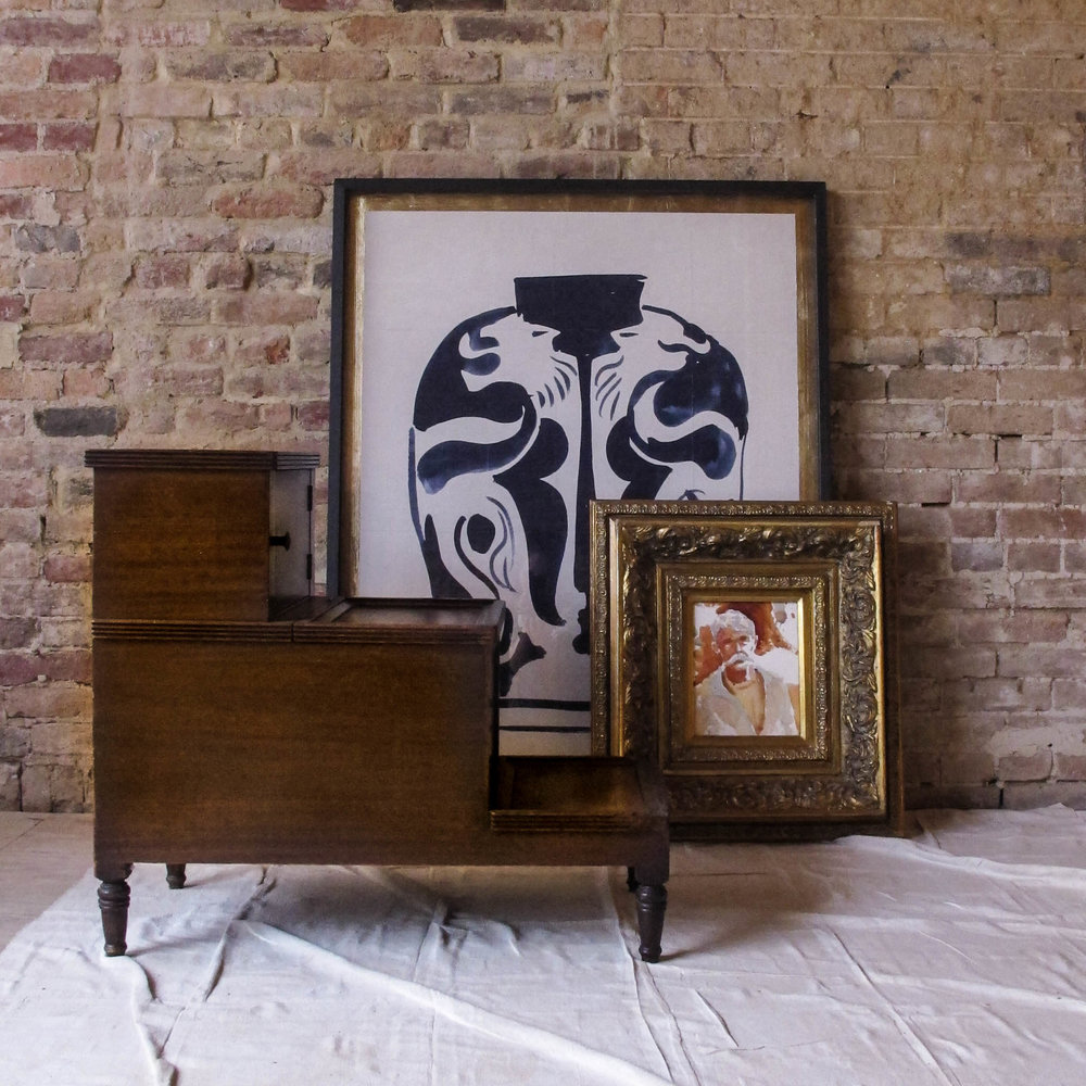 Antique bed steps and a collection of new and found art capture the essence of my design aesthetic.