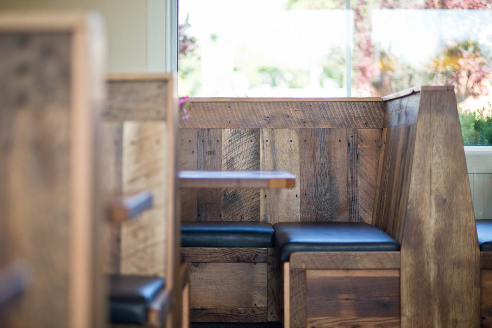 The custom built booths are made from reclaimed barn wood out of Ohio and Pennsylvania. There is a relaxed charm to reclaimed barn wood that instantly makes people feel at home.